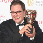 Alan Carr with his 2013 BAFTA